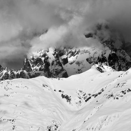 Black and white view on Mount Ushba in haze. Caucasus Mountains. Svaneti region of Georgia at winter. Square image.