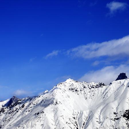 Snow mountain at sunny winter day. View from ski lift on Hatsvali, Svaneti region of Georgia. Caucasus Mountains. Square image.