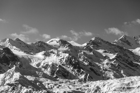 View on snowy mountains and glacier in nice sunny evening. Caucasus Mountains at winter. Svaneti region of Georgia. Black and white toned landscape.