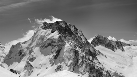 Black and white panorama of winter snowy mountain. Caucasus Mountains. Region Dombay, mount Dombay-Ulgen. Stok Fotoğraf