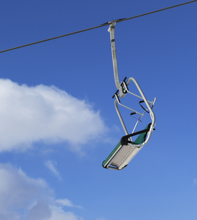 Ski lift and blue sky with clouds at sunny winter day Stock fotó