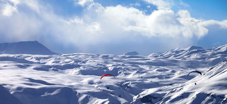 Panoramic view on speed flying in snowy winter mountains. Caucasus Mountains. Georgia, region Gudauri. Stock Photo