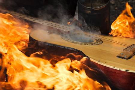 Guitar in flame on bonfire at forest Stock fotó