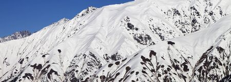 Panoramic view on mountains covered with snow at winter day. Caucasus Mountains. Georgia, region Svaneti.