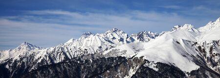 Panoramic view on snowy mountains in sun winter day. Caucasus Mountains. Svaneti region of Georgia.