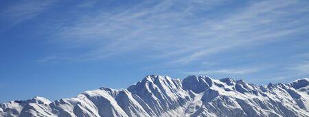 Sunlight snowy mountains in nice winter morning. Caucasus Mountains. Svaneti region of Georgia. Panoramic view.