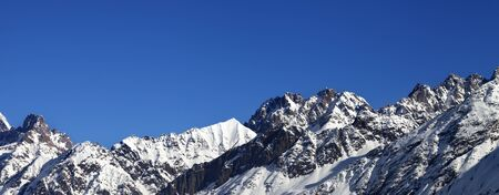 Panoramic view on snowy rocks and blue clear sky at nice sun day. Caucasus Mountains at winter. Svaneti region of Georgia.   版權商用圖片