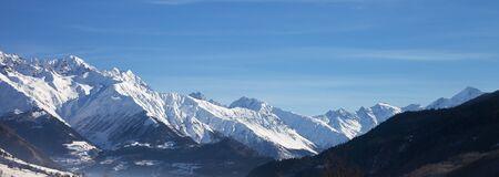 Panoramic view on snowy mountains and beautiful blue sky in nice sunny morning. Caucasus Mountains at winter. Svaneti region of Georgia. 版權商用圖片