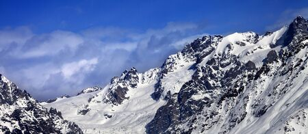 Mountains with glacier in snow at winter sun day. Panoramic view from ski lift on Hatsvali, Svaneti region of Georgia. Caucasus Mountains.