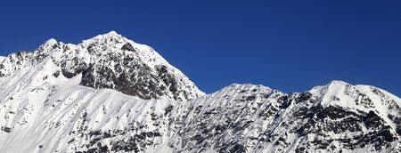 Snowy mountains and blue clear sky at cold winter day. Caucasus Mountains. Svaneti region of Georgia. Panoramic view. 版權商用圖片