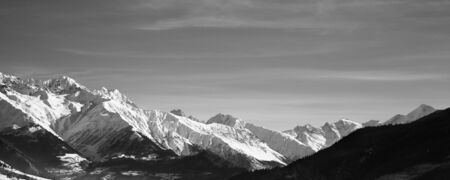 Panoramic view on snowy mountains in nice sunny morning. Caucasus Mountains at winter. Svaneti region of Georgia. Black and white toned landscape.