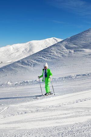 Skier on snowy ski slope at nice sunny day. Greater Caucasus in winter, Shahdagh, Azerbaijan. 版權商用圖片
