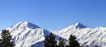 Panoramic view on snowy mountains and blue clear sky at nice sun morning. Caucasus Mountains. Svaneti region of Georgia.