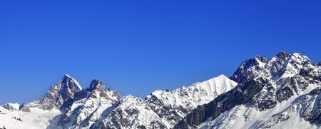 Panoramic view on snowy winter mountain peaks and blue clear sky at sunny day. Caucasus Mountains. Svaneti region of Georgia.