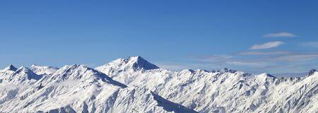 Panoramic view on snowy mountains in sunny winter day. Caucasus Mountains. Svaneti region of Georgia.