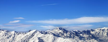 Snowy mountains and blue sky with clouds in nice sunny day. Caucasus Mountains at winter. Svaneti region of Georgia. Panoramic view.