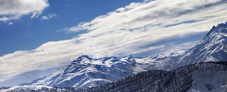 Panoramic view on snowy winter mountains in sun evening. Caucasus Mountains, Svaneti region of Georgia.