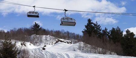 Chair-lift and snowy off-piste slope in ski resort. Caucasus Mountains at winter. Tetnuldi, Svaneti region of Georgia. Panoramic view. 版權商用圖片