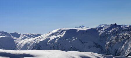 Panoramic view on snowy off-piste slope and blue clear sky in sun winter morning. Tetnuldi, Caucasus Mountains, Svaneti region of Georgia. 版權商用圖片