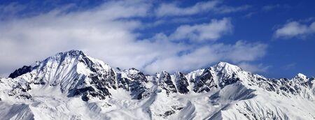 Snowy mountains in winter sun day. Panoramic view from ski lift on Hatsvali, Svaneti region of Georgia. Caucasus Mountains. Standard-Bild