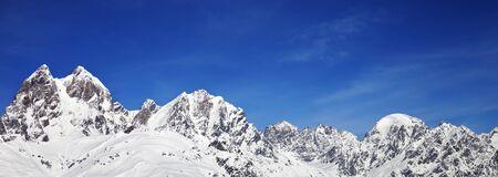 Panoramic view on snowy mountains at sunny winter day. Caucasus Mountains. Svaneti region of Georgia, Mount Ushba.
