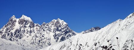 Panoramic view on snowy mountains and blue clear sky at winter. Mounts Ushba and Chatyn, Caucasus Mountains. Svaneti region of Georgia. Standard-Bild