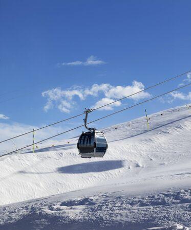Snowy slope and gondola lift on ski resort at windy sun day. Caucasus Mountains at winter, Shahdagh, Azerbaijan. Stock fotó