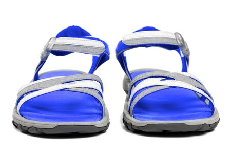 Pair of blue summer sandals isolated on white background. Front view.