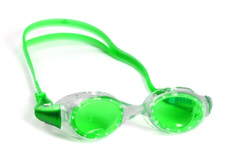 Light green goggles for swimming with water drops. Isolated on white background.