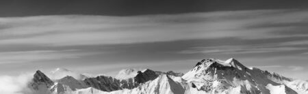 Black and white panoramic view on snowy mountains in winter. Caucasus Mountains, Georgia, region Gudauri.