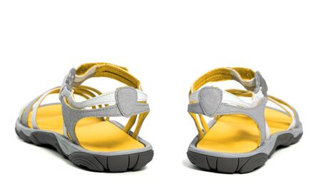 Yellow Summer sandals. Isolated on white background. Back view. Imagens