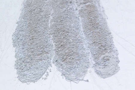 Trace of avalanche in high snowy mountains. Close-up view.
