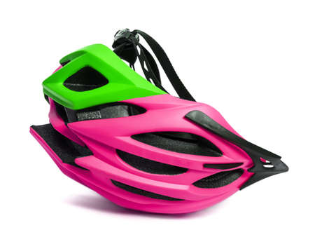 Female multicolor bicycle helmet upside down. Isolated on white background with shadow