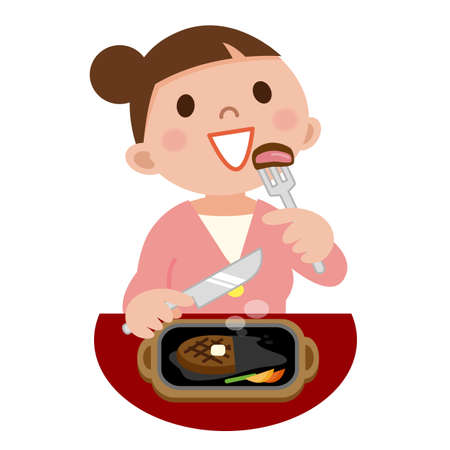 Young woman eating steak