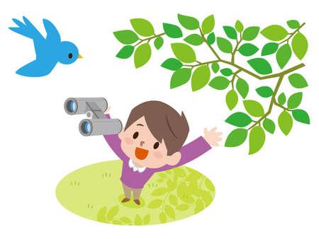 Un petit garçon utilise des jumelles pour observer les oiseaux dans la nature