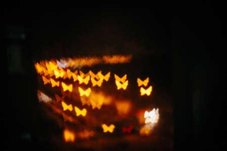 Multicolour bokeh butterfly shape ,the art from night lights.