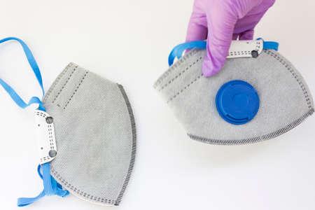 Coronavirus personal protective equipment concept with copy space. Medical ffp2 respirator. coronavirus flatly. take off medical masks with gloves. 版權商用圖片
