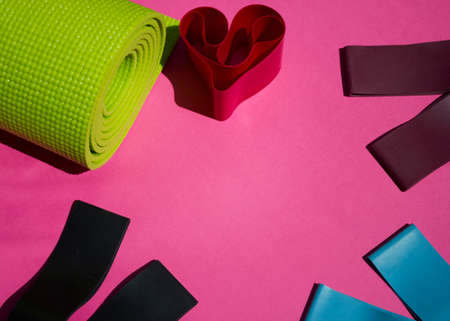 home sports equipment. Fitness and pilates gum. Pilates equipment flatly. Elastic expander. Sport and health concept.love sport.