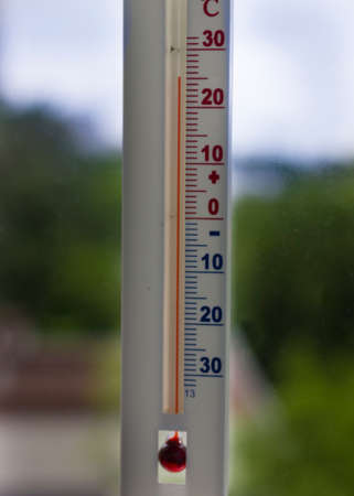 Measurement of air temperature in the street.window thermometer.