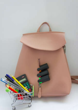 Pink backpack with school supplies isolated on white Archivio Fotografico
