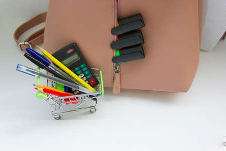 Pink backpack with school supplies isolated on white Stok Fotoğraf