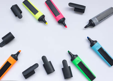 Colored highlighters on a white background.multicolored markers with open caps isolated on a white background copy space.