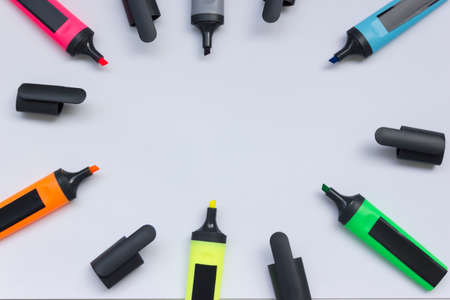 Colored highlighters on a white background.multicolored markers with open caps isolated on a white background copy space. 版權商用圖片