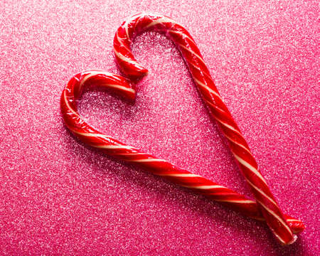 Christmas gift.Christmas candy cane in the shape of a heart.Valentines day gifts