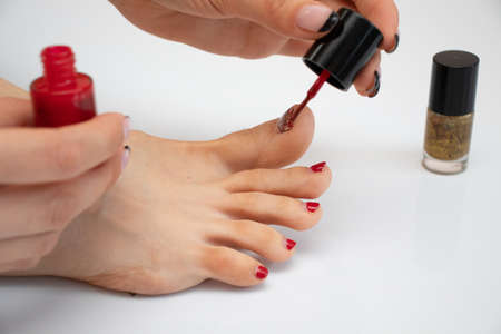girl makes a pedicure. girl paints her toenails. woman makes new pedicure.the process of applying pedicure