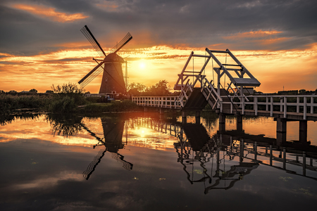 Sunrise on the Kinderdijk windmill built in 17 century, the UNESCO world heritage monuments in Alblasserdam, South West of Rotterdam, Netherlands