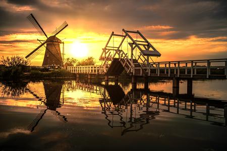 water mill: Sunrise on the Kinderdijk windmill built in 17 century, the UNESCO world heritage monuments in Alblasserdam, South West of Rotterdam, Netherlands