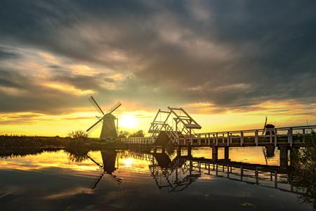 Sunrise on the Kinderdijk windmill built in 17 century, the UNESCO world heritage monuments in Alblasserdam, South West of Rotterdam, Netherlands