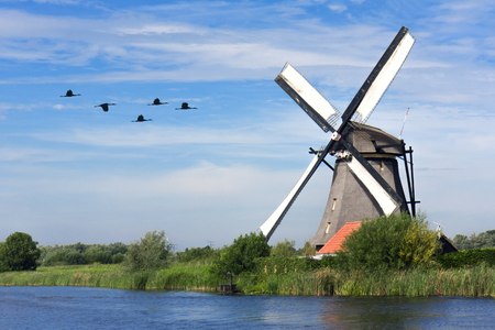 Sunrise on the Kinderdijk windmill, the UNESCO world heritage monuments in Alblasserdam, South West of Rotterdam, Netherlands