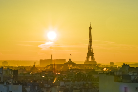 Sunset on the Eiffel tower in Paris Stock Photo